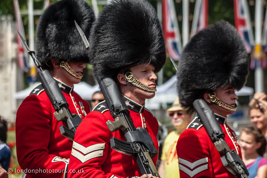 photograph of 3 guardsmen in red