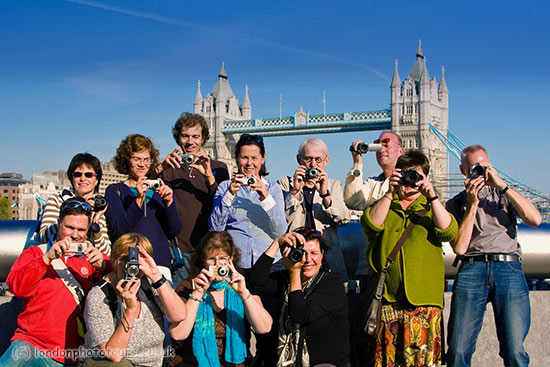 large group of photography students in front of Tower Bridge London