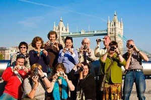 large group of photography students from Holland in front of tower bridge London