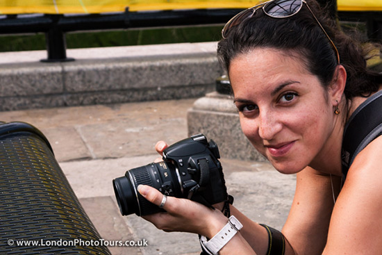 photography course student - beginners photography courses - woman using a DSLR camera