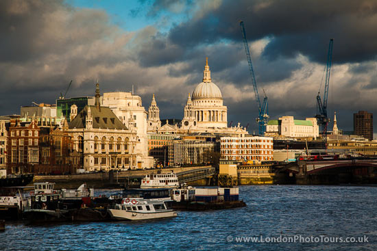 photo shot across the river Thames to St. Pauls cathedral
