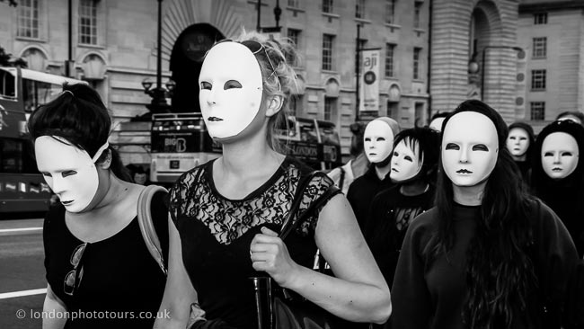 Street Photography London, example photograph marchers wearing masks near Westminster in black and white