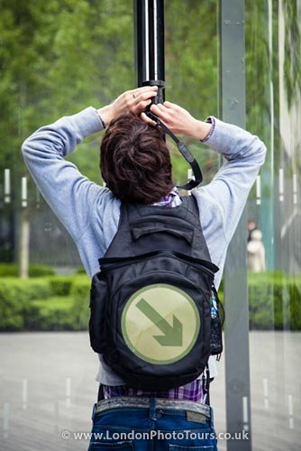Photography Courses Guide - student taking a photograph near building